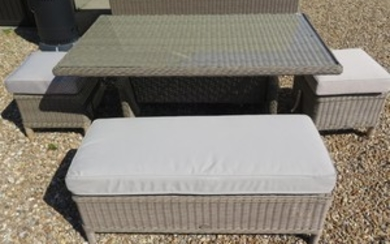 A Bramblecrest Cotswold casual dining set with a table, two ...