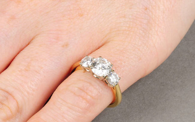 A brilliant-cut diamond three-stone ring. With reports