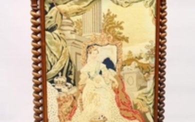 A VICTORIAN ROSEWOOD FRAMED FIRESCREEN, with woolwork