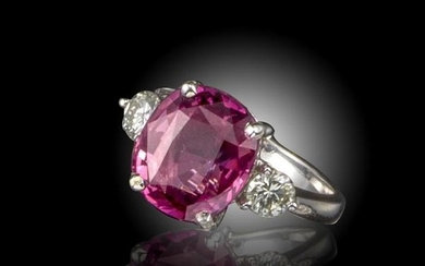 A pink spinel and diamond ring, the cushion shaped…