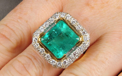 A Colombian emerald and pave-set diamond cluster ring.