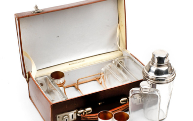 A leather-cased travelling drinks set for four persons, circa 1909,