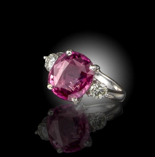 A pink spinel and diamond ring, the cushion-shaped...