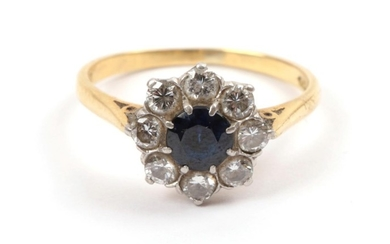 An 18 Carat Gold Synthetic Sapphire and Diamond Cluster Ring,...
