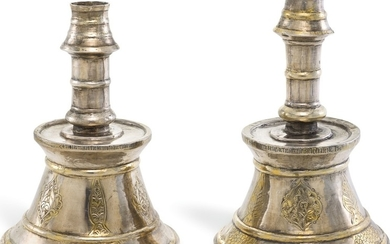 A RARE PAIR OF OTTOMAN SILVER-GILT CANDLESTICKS WITH GREEK INSCRIPTIONS, TURKEY, DATED 1708