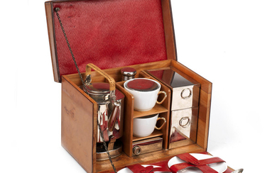 An Edwardian leather-cased tea-set for two persons, circa 1905,