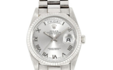 Rolex. A WHITE GOLD BRACELET WATCH WITH DAY AND DATE