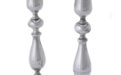 A pair of silver circular candlesticks by Joseph Gloster Ltd