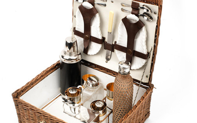 A wicker-cased picnic/drinks set for four persons by Barrett & Sons, circa 1905,