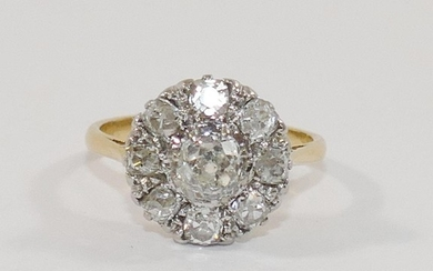 A diamond cluster ring, the centre old cut stone approximate...