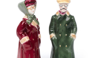 A pair of glazed ceramic 'The Motorist' candle snuffers by Royal Worcester,