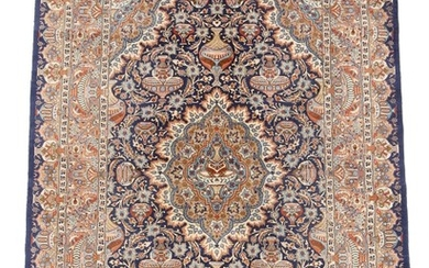 An Indian carpet, classic medallion design with vases, ornaments, flowers and foliage on blue base. 20th century. 334×245 cm.