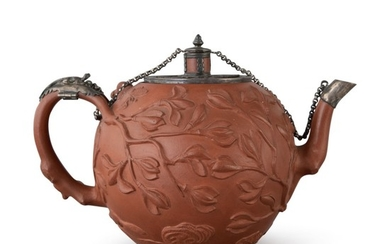 A CHINESE YIXING SILVER-MOUNTED 'SQUIRREL AND MAGNOLIA' TEAPOT AND COVER QING DYNASTY, 18TH CENTURY | 清十八世紀 宜興紫砂鑲銀松鼠玉蘭紋壺