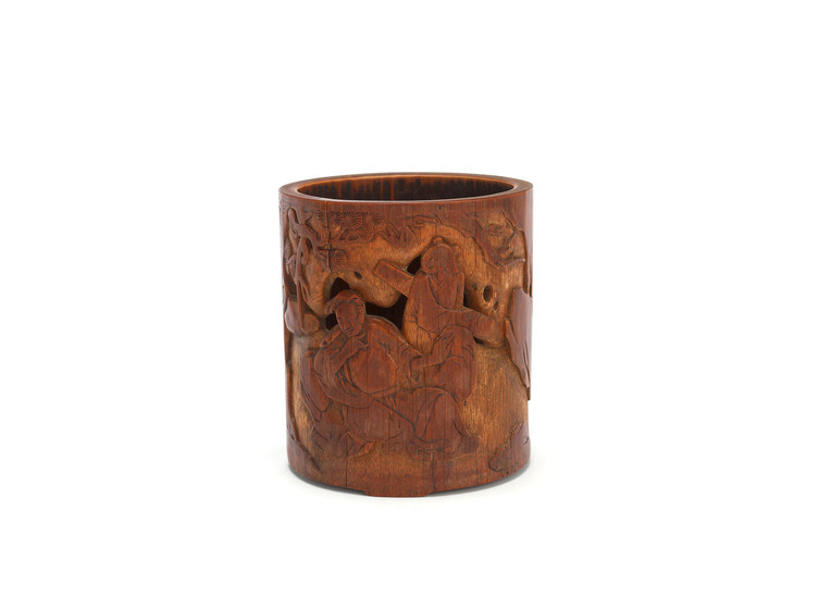 A carved and pierced bamboo brushpot
