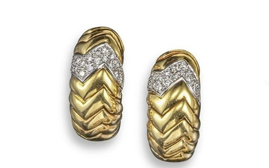 A pair of gold and diamond earrings, of fluted che…