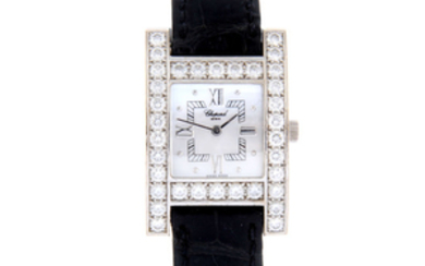 CHOPARD - a lady's 18ct white gold factory diamond set Your Hour wrist watch.
