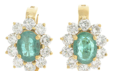 A pair of emerald and diamond cluster earrings.