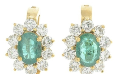 A pair of emerald and diamond cluster earrings. Emerald