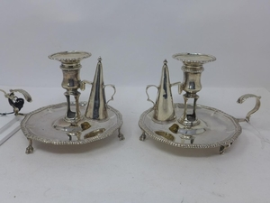A pair of George III silver chambersticks with snuffers, by ...