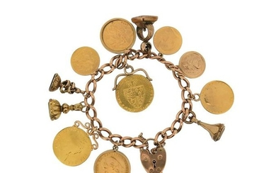 A gold charm bracelet, the 9ct gold curb...