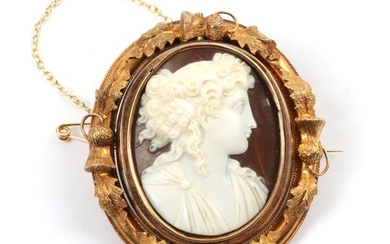 A Cameo Brooch, the classical figure within a frame with...