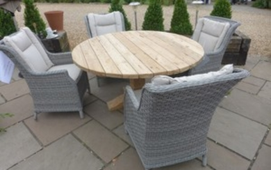 A Bramblecrest Kuta 145cm round table with four dining armch...