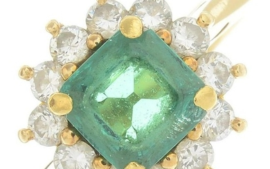 An emerald and diamond cluster ring. Emerald calculated
