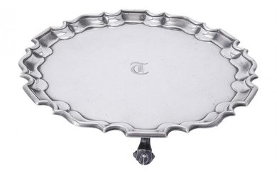 A silver shaped circular salver by Thomas Bradbury & Sons