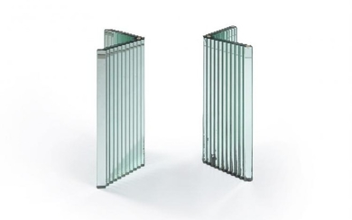 A pair of slab glass table supports