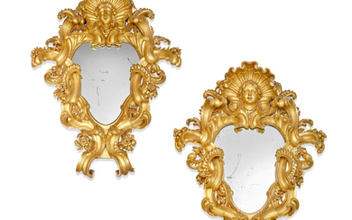 A monumental pair of Italian Baroque carved giltwood mirrors