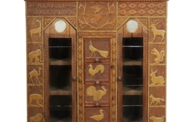 """Carved, punch and paint-decorated bookcase/cabinet """"Made by Stanley Slowik,""""..."""
