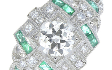 A diamond and emerald ring.