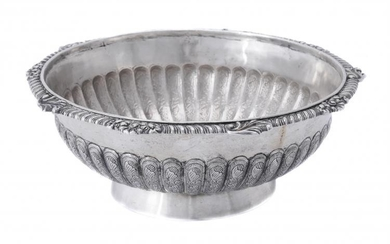 A silver shaped circular bowl