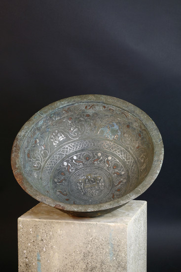 A large Persian bronze basin with silver, copper and brass inlay
