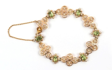 An Early 20th Century Peridot and Seed Pearl Bracelet, quatrefoil...