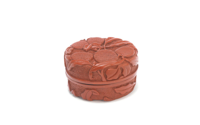 A carved cinnabar lacquer 'lychee' box and cover