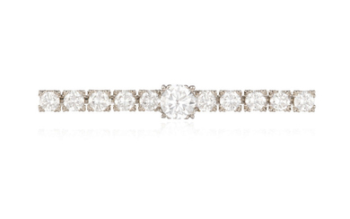 A DIAMOND BAR BROOCH The...
