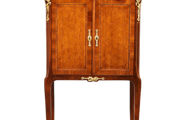 A French early 20th century mahogany, kingwood, parquetry and gilt metal mounted cabinet on stand