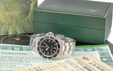 Rolex. A fine stainless steel automatic wristwatch with bracelet, original Guarantee, Sales Invoice and box, SIGNED ROLEX, REF. 5513, OYSTER PERPETUAL, SUBMARINER, 660FT=200M, CASE NO. 7'332'743, CIRCA 1982