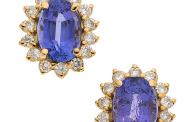 Tanzanite, Diamond, Gold Earrings The earrings feature oval-shaped tanzanite,...