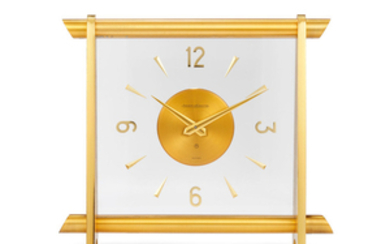 Jaeger-LeCoultre. A Gilt Brass Table Clock With 8-Days Power Reserve