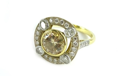 A diamond cluster ring, centrally set with round brilliant c...