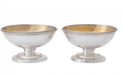 A pair of George III silver pedestal oval salt cellars by William Abdy I