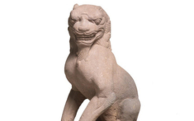 A stone figure of a seated lion