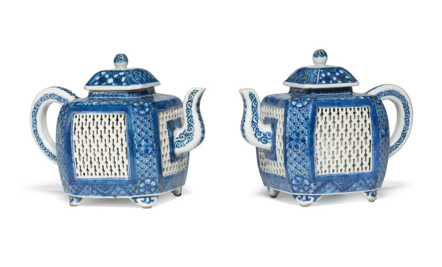 A rare pair of blue and white teapots and covers