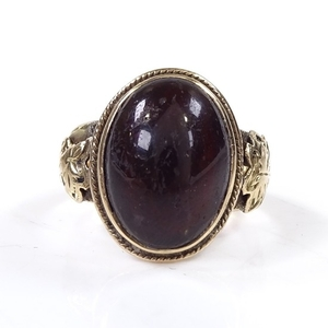 An Antique unmarked gold and cabochon red stone signet ring,...