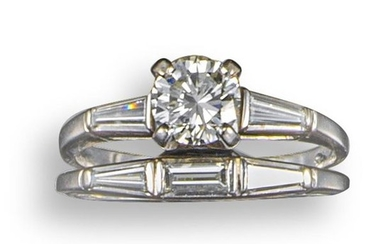 A diamond three-stone ring, set with a round...