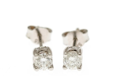 A pair of diamond solitaire ear studs each set with a brilliant-cut diamond totalling app. 0.40 ct., mounted in 14k white gold. (2)