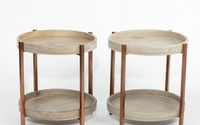 A pair of modern circular two-tier tables, with dished
