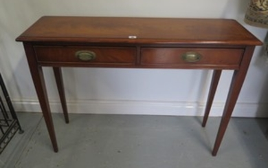 A mahogany hall table with walnut veneers, featuring two dra...